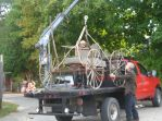 The crane hoists the buggy in place