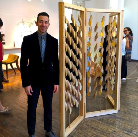 Bronsin Ablon with one of his designs.